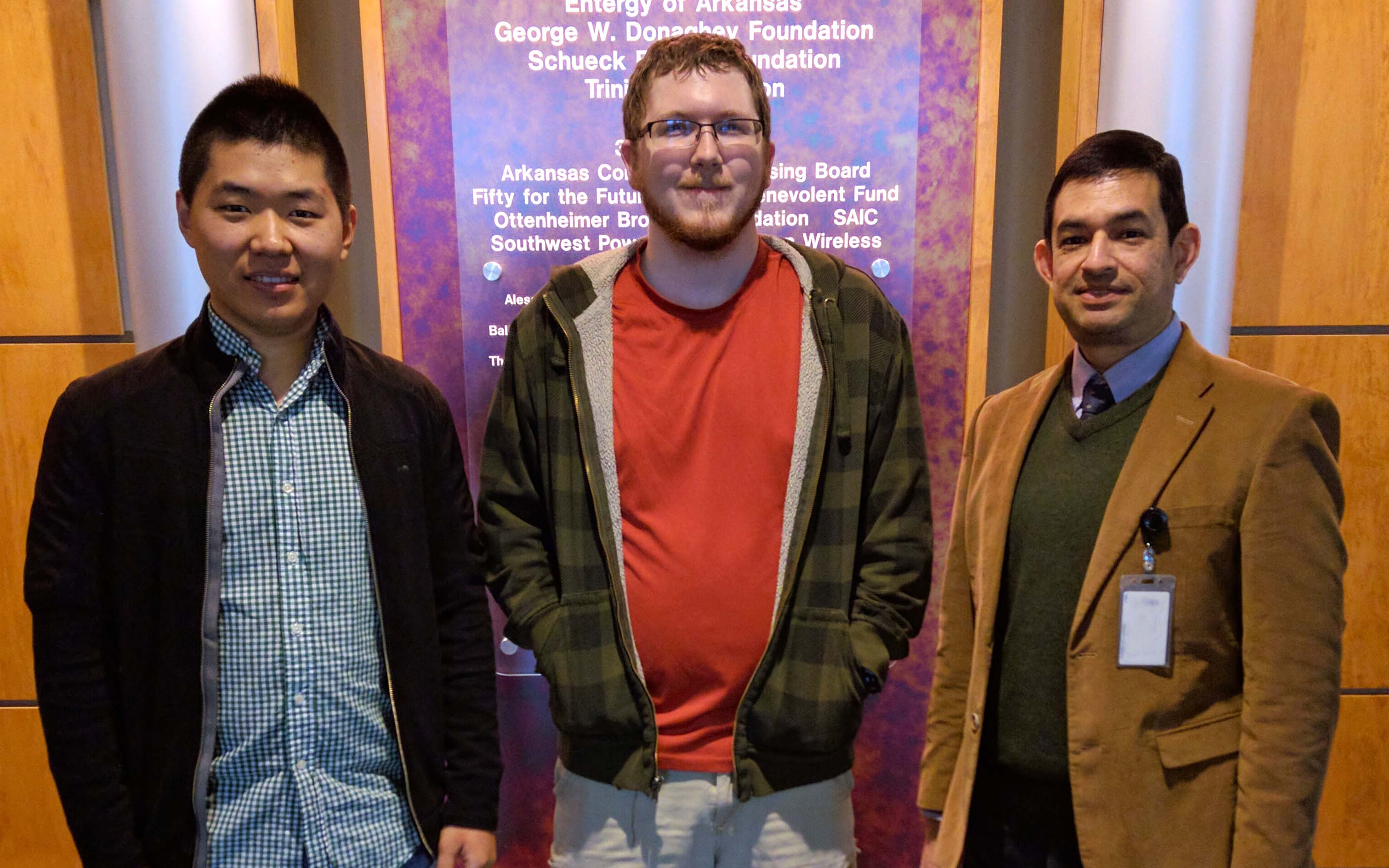 UALR cybersecurity team members (l to r) include Yanyan Li, Connor Young, and Hector Fernandez.