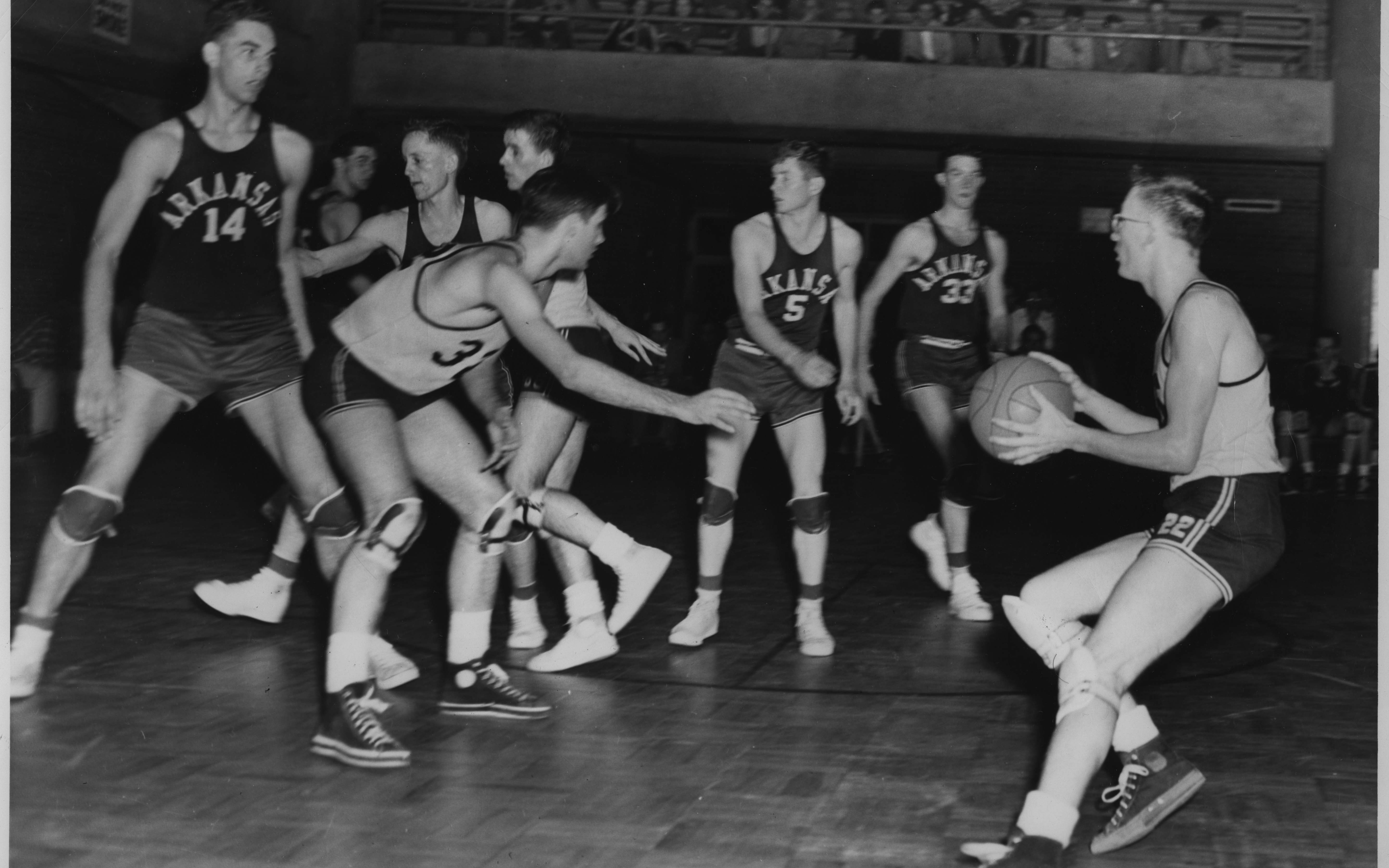 The Trojan basketball team from Little Rock Junior College competes in a game in 1950. (Courtesy of UA Little Rock Center for Arkansas History and Culture)