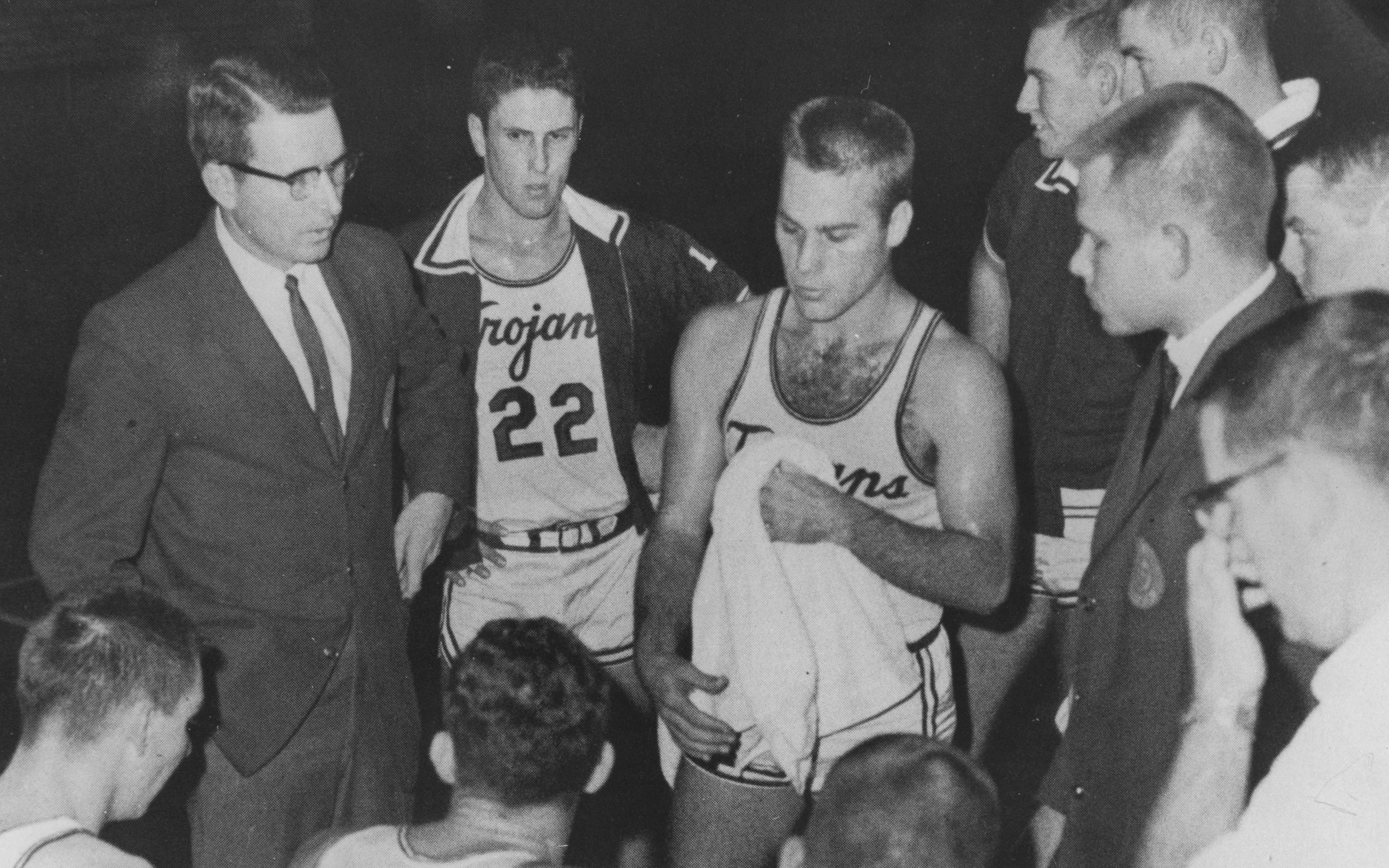 Trojan Basketball Coach Bill Ballard (left) discusses strategy with players Don Hurst, Freddie, Eastin, and assistant coach Cleve Branscum during the 1964 season. (Courtesy of UA Little Rock Center for Arkansas History and Culture)