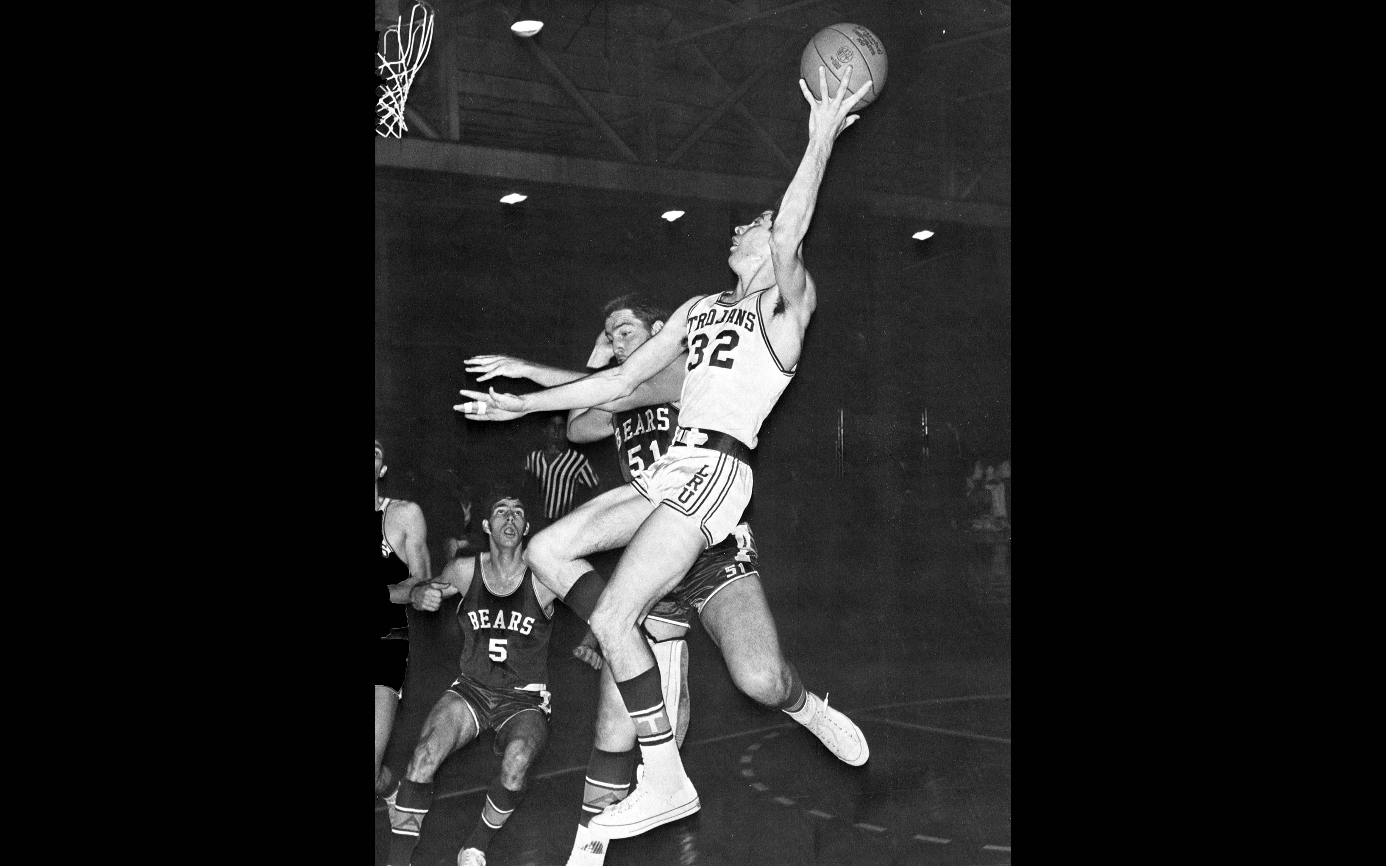 Unable to get under the basket for a lay up, Cecil Wicker used the hook shot to good advantage. (Little Rock University Yearbook, Vol. 41, 1969)